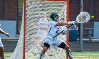 Riverside Rams Lacrosse goalie saves a shot