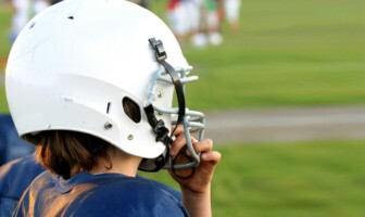 Child wearing a football helmet