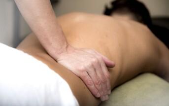 Man having his lower back massaged