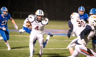 Briar Woods junior running back Evan Rutkowski breaks free from a tackle