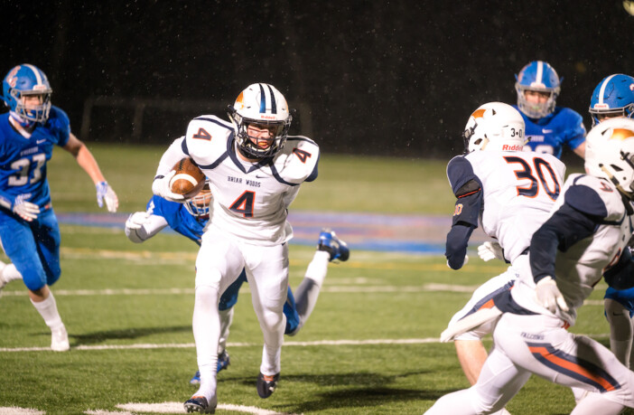 Briar Woods junior running back Evan Rutkowski breaks free from a tackle