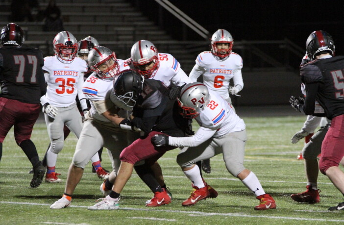 Park View's Atif Aslam, Caleb Park, and Derek Ramirez make a group tackle in their win over Rock Ridge on March 19